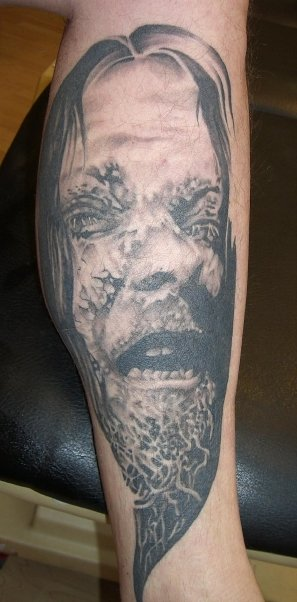 tattoo_arm_gesicht